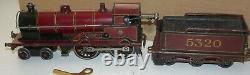 Bing O Gauge C/w'mercury' Locomotive And Tender In Lms Red Livery With Box