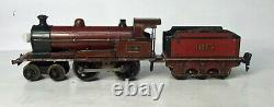 Marklin O gauge electric LMS locomotive and three coaches