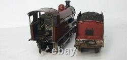 Marklin O gauge electric LMS locomotive and three coaches